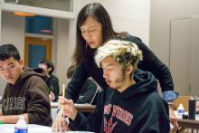 students paining, calligraphy, teacher instructing