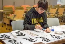 student paining, calligraphy, characters