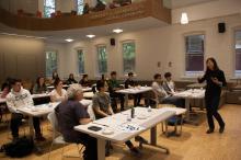 Kiri Lee teaching Asian Studies calligraphy class in Williams Hall Global Commons
