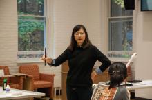 Kiri Lee teaching class how to hold calligraphy brush