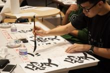 ASIA 090 student practicing calligraphy