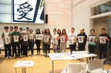 students paining, calligraphy, artwork presentation, whole class, class photo