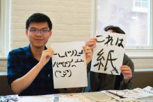 Lehigh Lunar New Year Celebration participants practice Japanese caligraphy